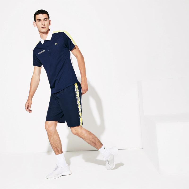 Short Tennis Lacoste Sport Bleu Marine avec Bande Jaune Lacoste