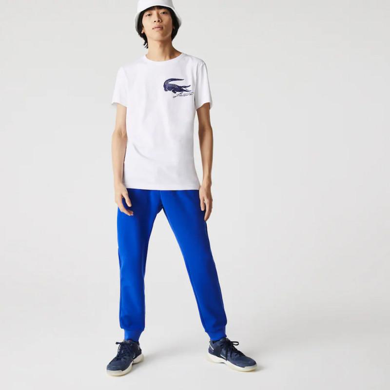 Pantalon de jogging uni Lacoste avec empiècements en mesh bleu
