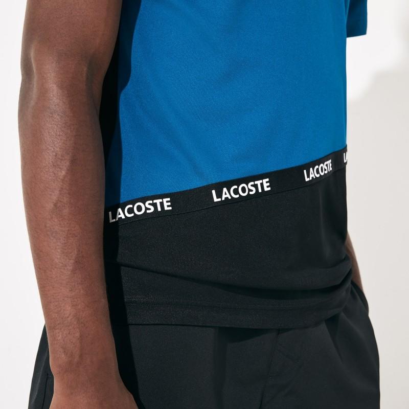 Polo Lacoste SPORT bleu/noir en piqué respirant color-block avec bande signature