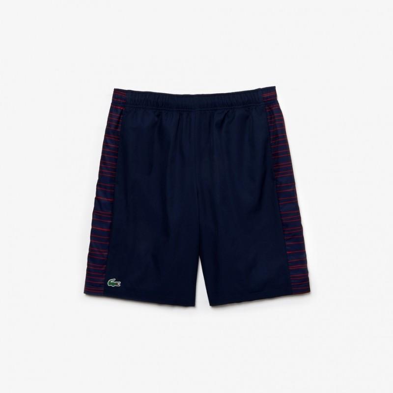 Short Tennis Lacoste SPORT bleu/rouge avec bandes latérales imprimées