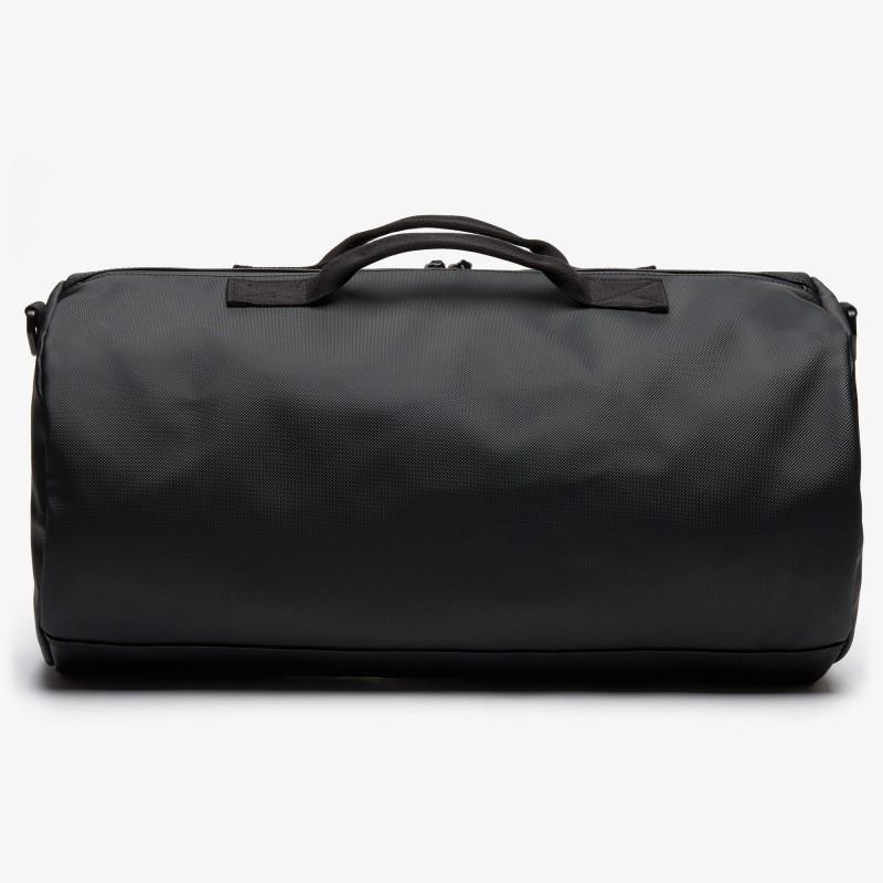 Sac polochon Lacoste noir L.12.12 Concept en toile enduite unie