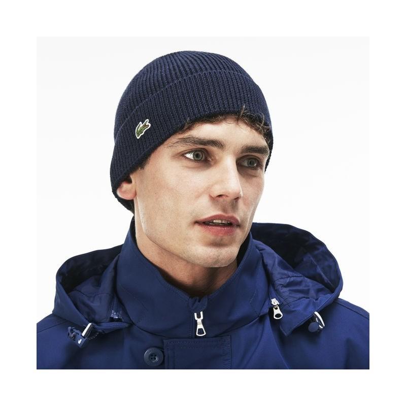 Bonnet Lacoste bleu à revers en laine côtelée unie