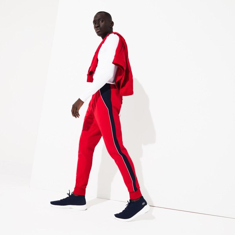 Jogging Lacoste SPORT rouge/bleu en molleton avec bandes